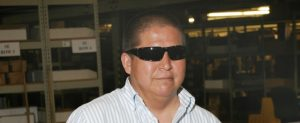 A picture of an AIB Employee in the warehouse in front of racking and shelving.