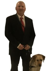 Picture of an AIB Employee with his Guide Dog