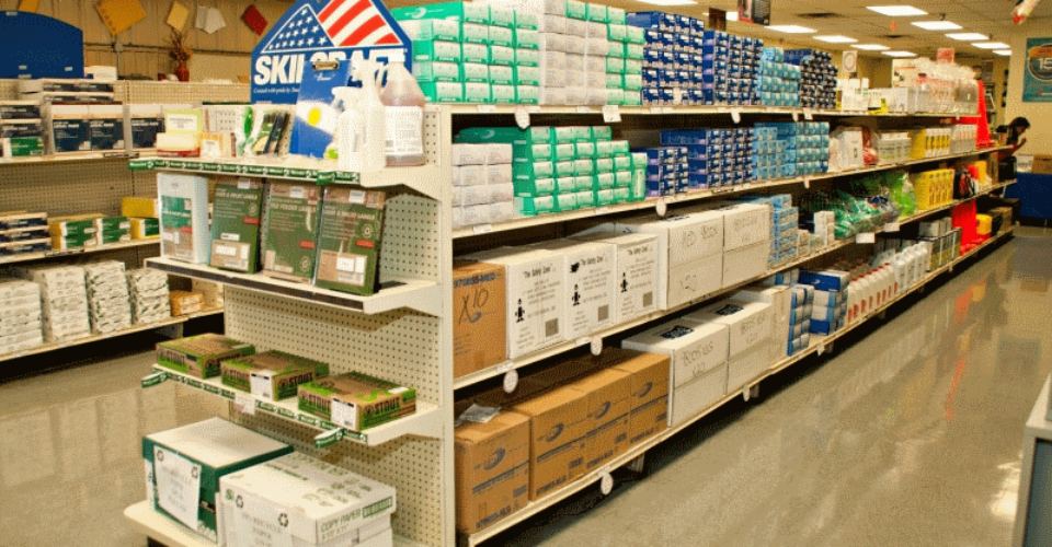 A picture of an aisle with shelving full of product.