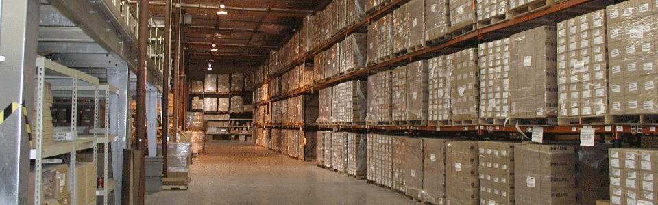 A photo of shrink-wrapped pallets on racks in the AIB Warehouse.