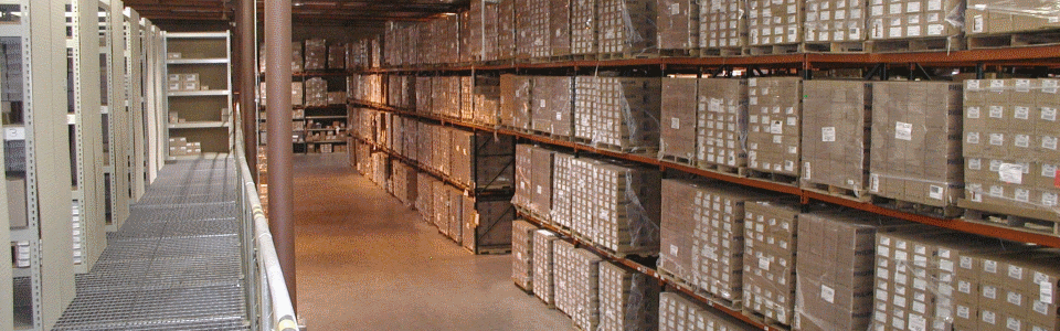 Picture of shrink wrapped pallets stored in Racks in the DSU Warehouse.
